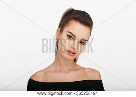Female Model Standing Frontal Looking At Camera Over White Background. Beautiful Woman With Brunette
