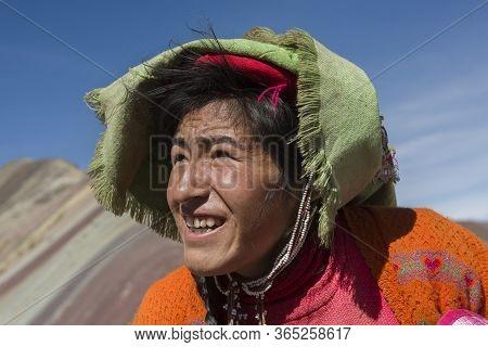 Vinicunca, Cusipata, Peru - June 08, 2017: Peruvian Andean Woman Wearing Traditional Colorful Clothi