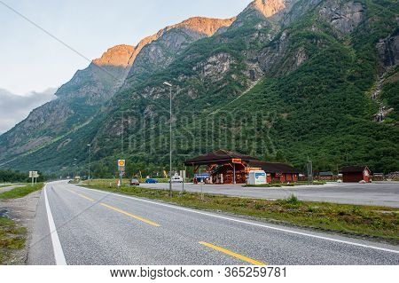 July 27, 2013, Gudvangen, Norway: A Motorway With A Gas Station On The Background Of A Beautiful Mou