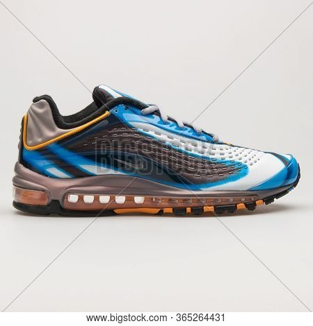 Vienna, Austria - June 14, 2018: Nike Air Max Deluxe Blue, Grey, Brown And White Sneaker On White Ba