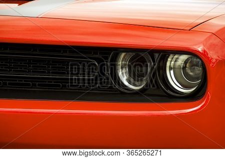 Car Headlights. Luxury Headlights. Front Of The Car Close Up. Red Car