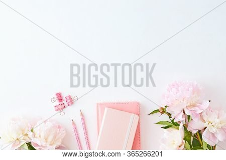 Blogger Or Freelancer Workspace With Notebook And Light Pink Peonies On A White Background