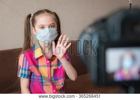 Beautiful Cute Little Blogger Girl Recording A Video For Her Followers. Little Blogger Girl Greets T