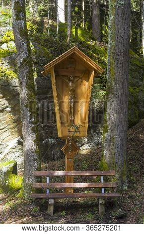 A Pillar With A Crucifix On A Mountainside Trail. Austrian Alps, Tyrol, Surroundings Of The Mayrhofe