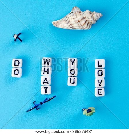 Little White Dices Forming A Text Do What You Love As Positive Lifestyle Theme On Blue Background