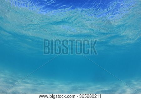 Underwater clear blue sea and sandy ocean bottom