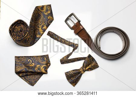 Accessories, Belt, Bow-tie, Tie And Scarf. Shot From Above, On A White Background.