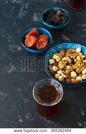 Turkish And Oriental Sweets Dried Dried Apricots, Prunes, Marshmallows, Nuts Lie In A Blue Bowl, And