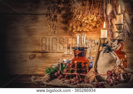 Magic Potions On The Witch Doctor Table Background. The Witchcraft.