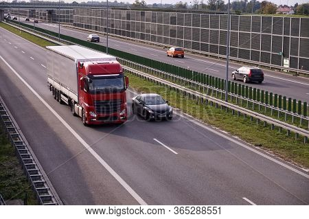 Road Transport. Acoustic Barriers On The Highway Protecting Residents Against Noise Generated By Car