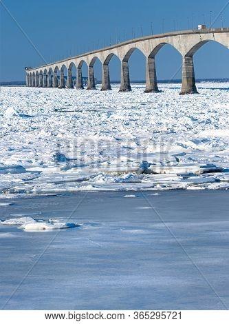 The Confederation Bridge in winter linking Prince Edward Island and mainland New Brunswick, Canada. Viewed form the Borden, Prince Edward Island.