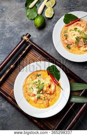 Asian Shrimp Tom Yam With Funchosa On White Plates. Top View, Copy Space