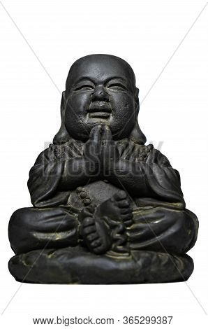 A Small Replica Statue Of The Buddha On White