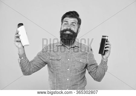 Bath Soap. Bath Cosmetics Review. Man Bearded Hipster Hold Plastic Bottles. Hair Care. Skin Lotion.