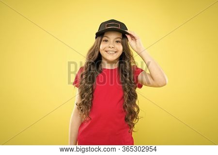 Comfy And Cool. Girl Long Curly Hair Wear Cap. Must Have Street Style Accessory Trends. Modern Fashi