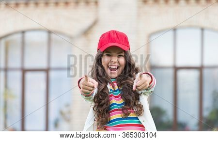 You Are In Good Hands. Happy Child Pointing Fingers Straight Outdoors. Marketing And Advertising. Ad