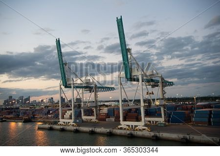 Miami, Usa - March 01, 2016: Cargo Cranes On Cloudy Sky. Containers In Cargo Port. Waterfront Cargo