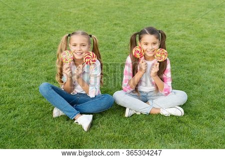 Candy Synonym For Happiness. Sugar And Calories. Joyful Cheerful Friends Eating Sweets Outdoors. Hol