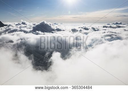 Clouds And Fog Over The Chamonix Valley. View From The Cosmique Refuge, Chamonix, France. Perfect Mo