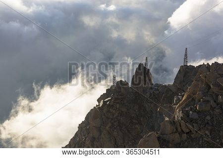 Clouds And Fog Near Aiguille Du Midi. View From The Cosmique Refuge, Chamonix, France. Perfect Momen