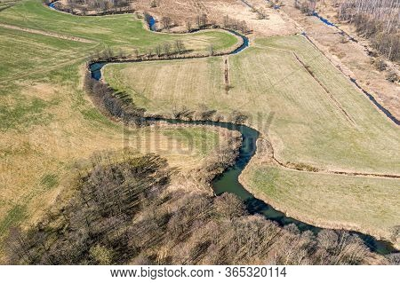 Aerial View Of Countryside Landscape With A Winding River At Sunny Spring Day
