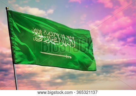 Fluttering Saudi Arabia Flag On Colorful Cloudy Sky Background. Saudi Arabia Prospering Concept.