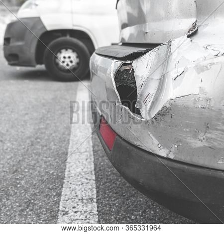 Damaged Car. Road Accident. Back Of Gray Car Get Damaged From Accident On The Road. Vehicle Bumper D