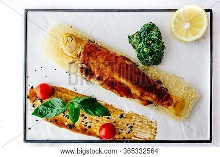 A Close Up Of A Plate Of Seabass
