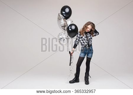 Cool Pre-teen Girl With Rock Sign. She Is Showing Rock N Roll Or Horn Sign, Gesturing At Camera And