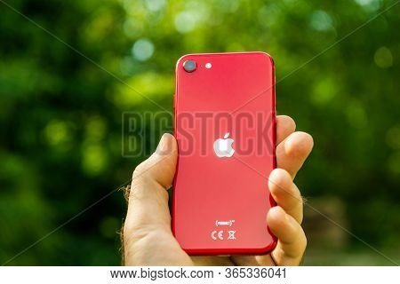 Paris, France - Apr 24, 2020: Man Hand Showing Rear Logotype On New Budget Iphone Se By Apple Comput