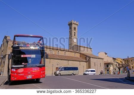 Fiesole, Tuscany, Italy, March 30, 2019: Red Hop On Hop Off Touristic City Sightseeing Bus In Front