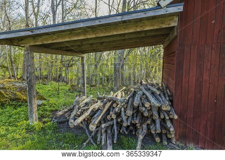 Close Up View Of Overhang Of Typical Swedish Old Red Wooden Country House In Forest. Beautiful Natur