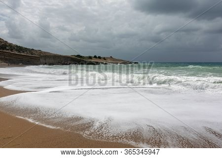 Dramatic Rainy Sky And Stormy Waves On A Sand Beach Of The Aegean Sea In Rhodes.