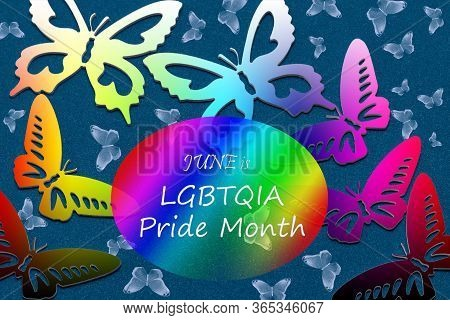 June Is Lgbtqia Pride Month. Greeting Text And Rainbow-colored Butterflies On A Blue Background.