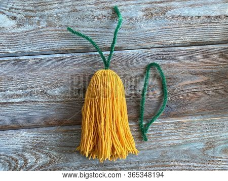 The Tassel Out Of Yellow Yarn, A Tutorial On How To Make A Monster, A Childrens Craft.
