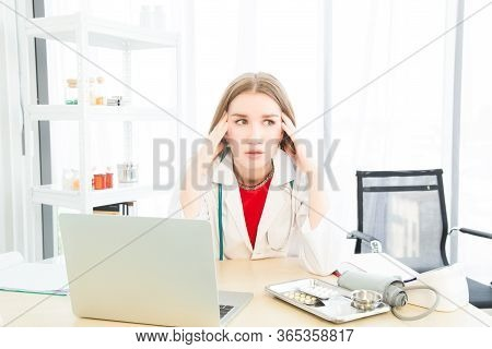 Female Beautiful Wearing A Doctor Uniform Doing A Headache Or Stressed Posture Case Of Treatment.
