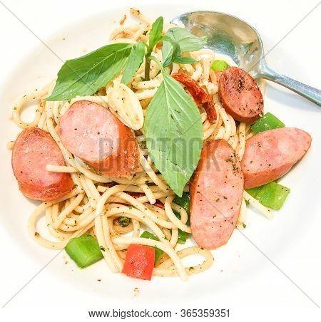 Stir Fried Spaghetti Dried Chili With Pork Sausage, Bell Pepper, Garlic And Basil.