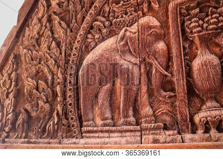 Elephant Depiction.piece Of Wood Curving Art, Isolated Vintage Pattern Curved In Wood