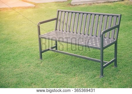 Stylish Bench In Summer Park. Public Chair In The Garden At Morning And Tree In Nature Background,pu