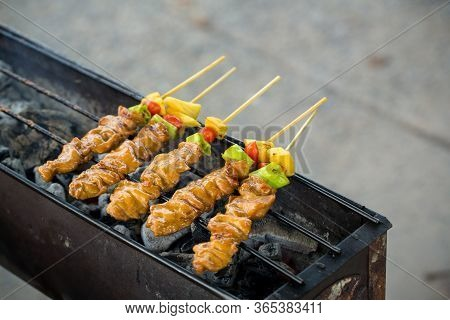 Bar-b-q Or Bbq With Kebab Cooking. Coal Grill Of Pock Meat Skewers With Pineapple And Green Pepper.
