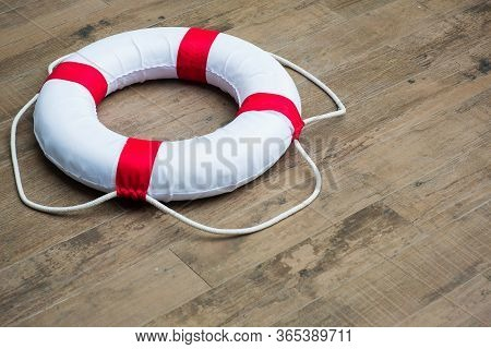Lifebuoy, All Water Rescue Emergency Equipment. White  And Red Lifebuoy On Brick Wall. Nearby The Sw