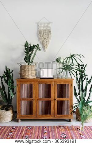 Vertical Photo Of Room With Vintage Decor In Stylish Ethnic Interior Design, Wooden Commode, Copy Sp