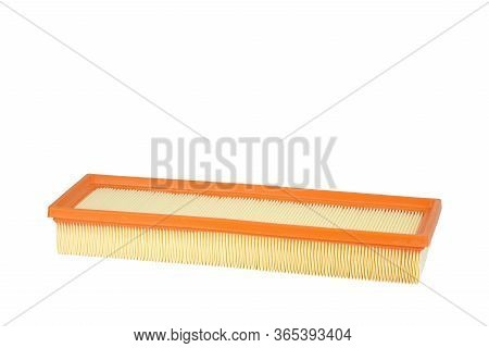 Isolate. The New Yellow-orange Car Air Filter On A White Background. Spare Parts For Vehicle Mainten