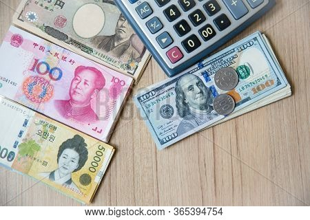 Many Banknote Currency, Yen-japan,dollar-usa,yuan-china, Won-korea With Calculator And Coins. Image