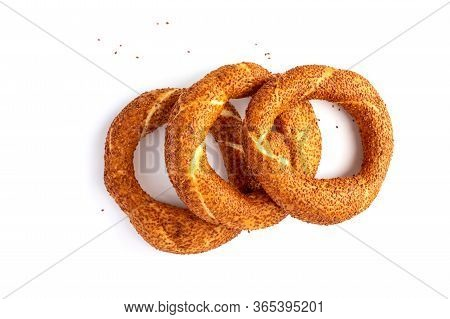 Three Traditional Turkish Crispy Bagel With Sesame, On White Background.close Up. Sesame Bread Rolls