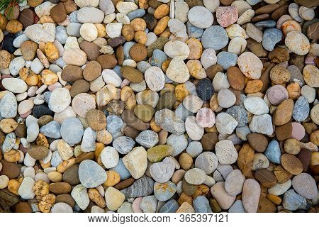 Sea Pebbles. Small Stones Gravel Texture Background. Pile Of Pebbles, Thailand. Color Stone In Backg