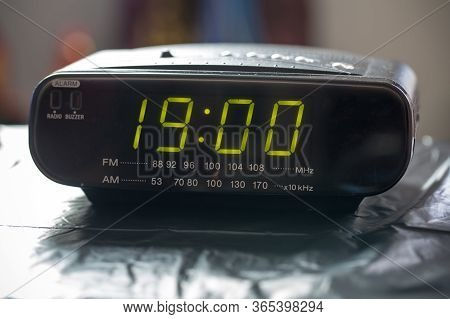 Black Digital Alarm Radio Clock.alarm Radio Clock Indicating Time To Wake Up. Digital Clock Closeup