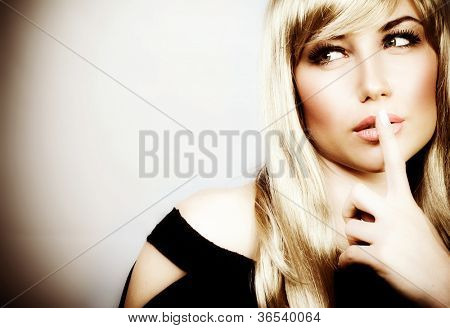 Photo of attractive woman expression silent, picture of mysterious girl show hush gesture, closeup portrait of young mum sign shh, image of blonde female with finger near lips, concept of silence
