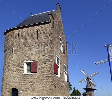 The Molen De Roos Windmill In Delft, The Netherlands. The Mill Dates From The 14th Century And Took
