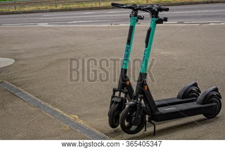 Stuttgart,germany - May 01,2020:berliner Platz These Are Two Green Scooters Of The Company Tier.peop